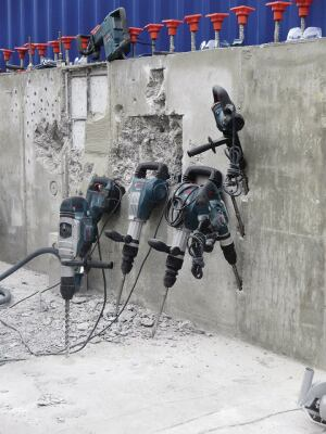 Bosch breakers and rotary hammers during a rare moment of rest at the show. Most of the time someone was hammering or drilling away with them on the concrete wall behind.