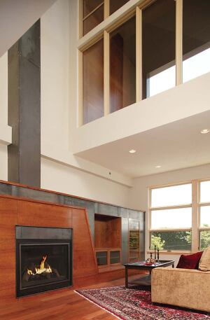 Sprocket Design-Build chose steel for this home's fireplace surround and chimney (left). Division1's Lacey project (above) will have cantilevered steel framing, stairs, and privacy screens.
