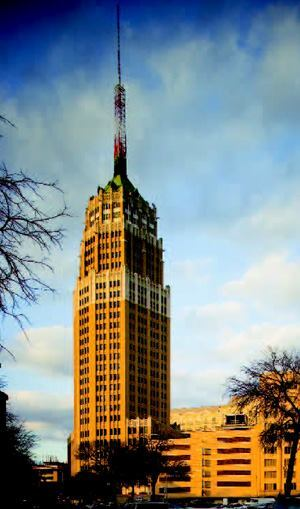 The Tower Life Building stands tall in San Antonio's downtown and River Walk area.