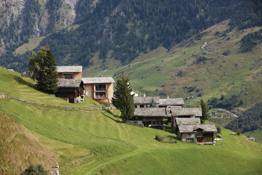 Zumthor's two wood-framed houses in Leis, Switzerland, sit perched above a collection of other dwellings. The architect uses the houses as a vacation getaway from his studio and residence about an hour away.