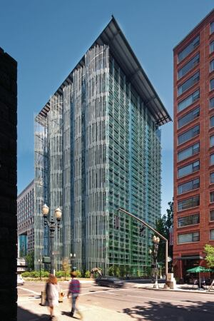 """The west façade is clad in a series of aluminum """"reeds,"""" which shade the building from the strongest direct sun. The curtainwall from Benson Industries is more visible on the south façade, where fixed sunshades mitigate glare and solar gain."""