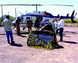 A radio repeater is air-lifted to Cat Mountain in a Pima County. Repeaters include  the pole, enclosure, solar panel, regulator, battery, cabling, and antenna. Photo: Richard  Sloan.