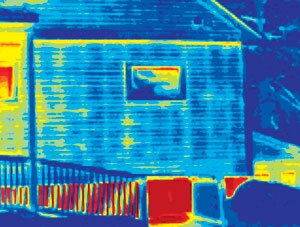 """BEAT THE HEAT: Wood transmits heat to the outside much more than insulation. That difference shows up in thermal photographs like this one. Here, the studs and top plate show up as much """"hotter""""--yellow rather than blue--compared with the insulated spaces nearby. Energy efficiency standards going into effect soon will aim to reduce this so-called thermal bridging."""