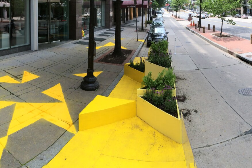 The original design, pictured above, included chalk triangles on the sidewalk. According to the designers, rain has since muddled these sidewalk designs.