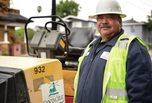 """Like many Santa Cruz public works employees, Street Maintenance Crew Leader Jess Davila grew up in the city. """"It means a lot to me to provide quality service to the town that's been home to me, my wife, and children,"""" he says."""