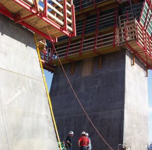 Concrete for the huge diamond-shaped towers was placed in 14-foot lifts into Peri's self-climbing forms.