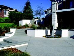 A natural concrete appearance is something many designers prefer. This Lithocrete installation achieves just that with integral color, surface seeded stones that are ¼ inch and minus, and control joints that contribute to the overall geometry.