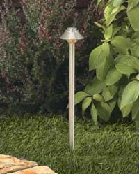 "PATH FINDER: Vista's stainless steel petite path light will brighten up any property. Model 2167, designed to specification grade standards, features a ""turn-to-lock"" lamp base for easy servicing. The optical-grade frosted lens is fitted with a silicone gasket for a weather-tight seal. The fixture measures 16-1/2 inches high and has a 3-1/2-inch shade. The product can be mounted into threaded hubs in junction boxes, ground stakes, or floor-mounting canopies."
