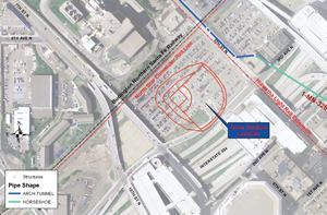 At 5th Street North between 2nd and 4th avenues, new Northstar Commuter Rail and Hiawatha Light Rail tracks intersect at an intermodal transit station across the street from the entrance to the Minnesota Twins' new open-air 39,504-seat baseball stadium. The railway bridge abutment had to be demolished to allow for the new commuter rail tracks. The bridge also had to be split in half the long way to flatten it for the extension of the tracks — occurring directly over the pipe on the centerline of Fifth Street. Images: Brown and Caldwell