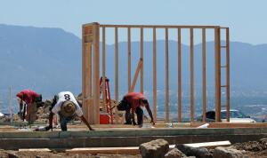 jt063015f/biz/jim thompson/A construction workers work on framing a home under construction on the westside of Albuquerque. Tuesday, June, 30, 2015.(Jim Thompson/Albuquerque Journal.)