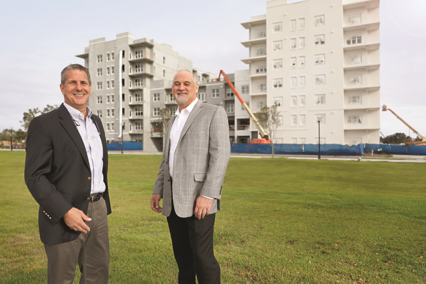 Alliance Residential's John Zeledon, left, and Bill Finfrock have enjoyed working together on Broadstone Winter Park (shown in background).
