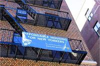 Development and finance partners celebrated the completion of the 72-unit building at 552 Academy Street in Inwood in mid-April.