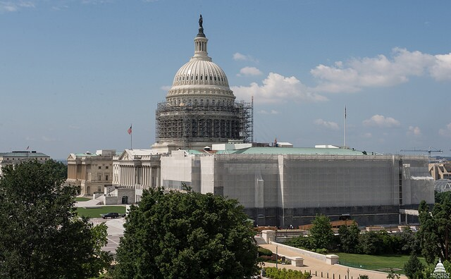 A scaffolding system was utilized on the exterior of the Capitol so that workers could both transfer materials to the site and work on it firsthand.