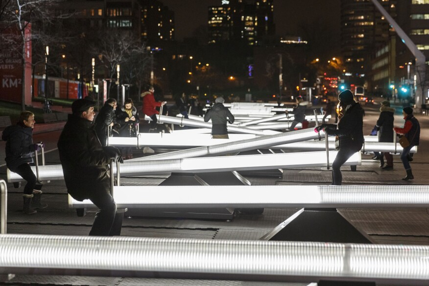 Impulse is an installation of 30 giant illuminated seesaws.