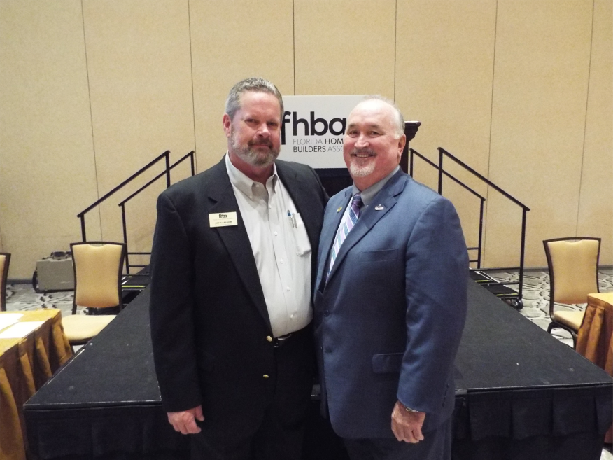 Jay Carlson, left, with 2015 Florida Housing Hall of Fame inductee Tom Thornberry.