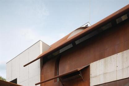 The entry facade is clad in Cor-Ten steel.