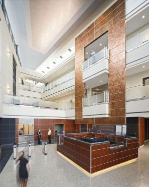 Passive daylighting strategies in the transparent, multi-story atrium allow natural light to filter into the inner core spaces of the facility. The tall interior volume of space is an integral component of the building's operation.