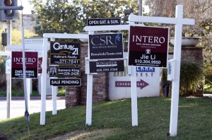 Real estate signs cover the lawn at a condominium complex on Moorpark Ave in San Jose, Calif., on Thursday, Jan. 7, 2016. (Karl Mondon/Bay Area News Group)