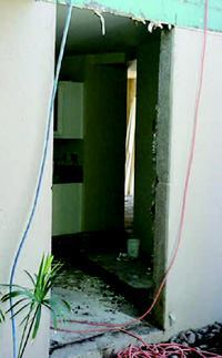 A sawcut was made in the 5½-inch-thick concrete wall to add a window in the kitchen/dining area.