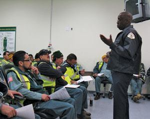 Capt. Reggie Grigsby of the Oceanside (Calif.) Police Department explains the Waste Watch program to solid waste collectors in San Diego. Photo: Waste Management