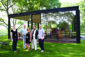 Looking glass: Titus Built staff Laura Koellmer, Burke Cheney, Stephanie Bell, Robert Mondello, and Dave Showalter.