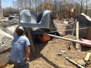 Contractors prop up a slide at its intended angle before fixing it in place.