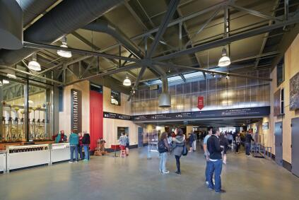 The Exploratorium lobby and ticketing area opens into the main exhibition hall on Pier 15.