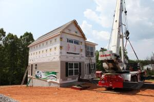 Landmark Setting Cranes place the modules on a jobsite in Axton, Va., for the 35,000th house that modular manufacturer Nationwide Homes has produced in its 52 years.