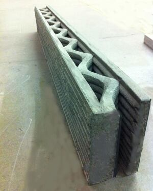 A reinforced, cast-in-place concrete wall extruded using Contour Crafting.