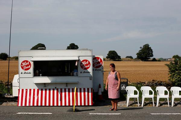 Vanessa Burras, 42, poses for a photograph outside her snack trailer along the A49 near Bristol, southwest England on Sept. 5, 2013. 2014 Sony World Photography Awards Professional Competition shortlist in the Travel category.