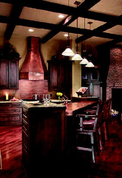 This inviting kitchen includes a rangehood and bar countertop made of copper.