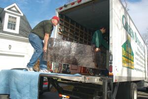 The crew carefully load a granite countertop into the truck from a home in Westchester County, N.Y.