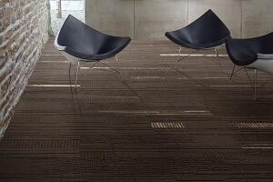Inspired by the natural simplicity of un-dyed wool and linen, Duo and Trio from Interface can be laid out in several patterns, including herringbone and linear designs. When installed in an ashlar coursing, the 25cm-by-1m plank tiles take on a seamless, broadloom-like look. Duo and Trio are made entirely from non-virgin yarn that is combined with reclaimed carpet fiber and salvaged fishing nets. interface.com