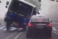 Ready Mix Truck Flips onto a Car