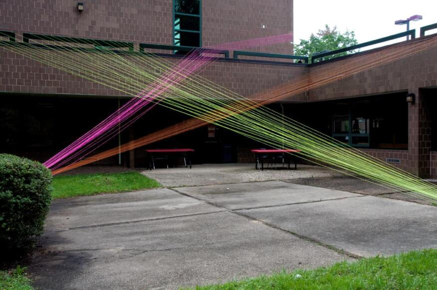 In Plane Sight Located in a sunken courtyard behind the library structure, In Plane Sight used a series of brightly colored neon strings, using the building's railing and anchors in the landscape to create a series of vivid planes that stretched a full story in height.