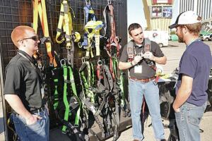 Experts demonstrate how to select, inspect, and adjust a body harness at the Fall Protection Showcase.