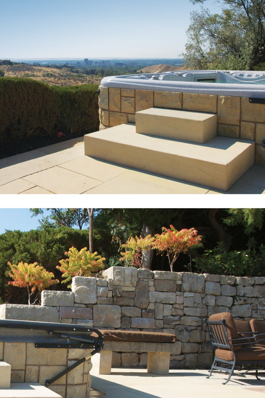 Smooth sandstone slabs step up to the hot tub, contrasting with the rustic chipped pieces of the hot tub stone veneer and the blocks of the retaining walls.