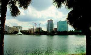 SPANNING TIME: The house physically and figuratively bridges two eras of Orlando's downtown housing history. To the north lies a historic grid of century-old, single-story homes; brick roads; and roundabouts that regulate traffic speeds (photos #3 and #4). A block to the south, views from the shore of Lake Eola (shown here) portray the city's ongoing condo boom and urban revitalization.