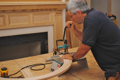 One of the best ways to  join the arched trim to the side jambs is with a dovetail machine that cuts small dovetail-shaped slots.