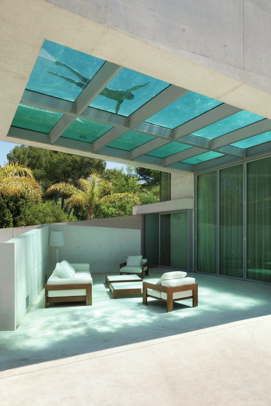 Patio shaded by the cantilevered swimming pool