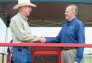 Dan Wallrath (left) thanks Dennis Knautz for Acme Brick Co.'s commitment to providing brick for Operation Finally Home.