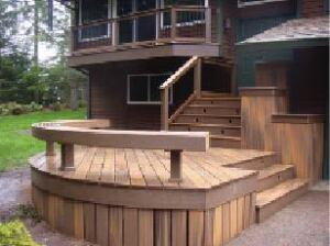 Figure 9. Planters fill an awkward space below the eaves and tie the deck to the ground.