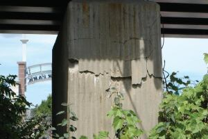 Although this ragged split concrete obviously should be repaired, it is likely at this point more cosmetic than structural. Located in Wisconsin, it may have been affected by water saturating the concrete then freezing.