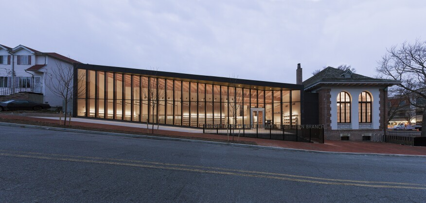 The new 12,000-square-foot addition to the Stapleton Library on Staten Island is a luminous rectangular box that flows easily from the existing structure.
