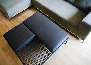 Alla Kazovsky Architects' new Perforations line of furniture and accessories explores the use of perforated steel paired with other materials to make versatile pieces. Featuring end tables, conference tables, partition screens, and sculptures, the collection celebrates the two-sided nature of the material. Each product can be used in multiple ways and material combinations. The On the Level coffee table (shown) is made up of rectangular steel tubing and a sheet of perforated steel. It can also be used as an ottoman when the accompanying square and rectangular leather cushions are added.  designedrealestate.com