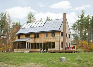 The zero-energy dwelling features south-facing solar panels discreetly tucked away on the back of the home.
