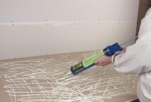 Green Glue Noiseproofing Compound    Green Glue Co.  greengluecompany.com  One layer between two drywall sheets or similar building material dissipates noise by up to 90% - Cuts out low-frequency noises produced by home entertainment systems - Can be applied with a standard caulking gun - Suitable for commercial and residential use and new construction and renovation projects - Low VOCs and no odor