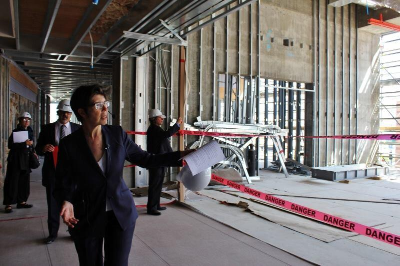 "Elizabeth Diller walks journalists through the second floor of the ""vault"" -- past a space that will be used as a public lecture room."