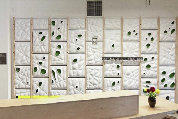 The VarVac Wall is installed in front of the reception desk in the University of Minnesota School of Architecture.