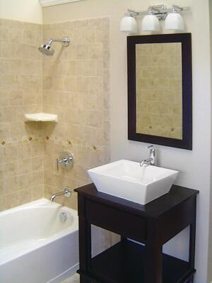 The Terranova Construction, Kitchen and Bath Zen Spa package ($17,900) includes this square vessel sink by Kohler, vanity from Woodpro, tub from Sterling (a Kohler company), and tile from Daltile.